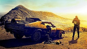 CONTEST CLOSED – Win An Autographed 'Mad Max: Fury Road' Poster Signed by Tom Hardy and Cast